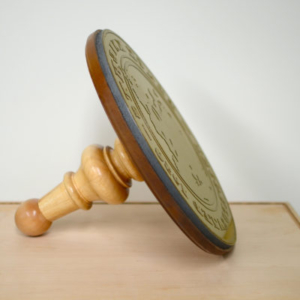 Ian Weaver, Seal, 2011-12, side view, wood, foam rubber, photopolymer plate, 16 inches diameter (seal); 12 inches (base length)