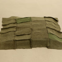 Helen Mirra, Eichenbuckel (oak hummock), 2002, stitched wool in two parts, 3 x25 1/4 x 26 7/8 inches