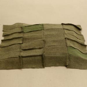 Helen Mirra, Eichenbuckel (oak hummock), 2002, stitched wool in two parts, 3 x25 1/4 x 26 7/8 inches