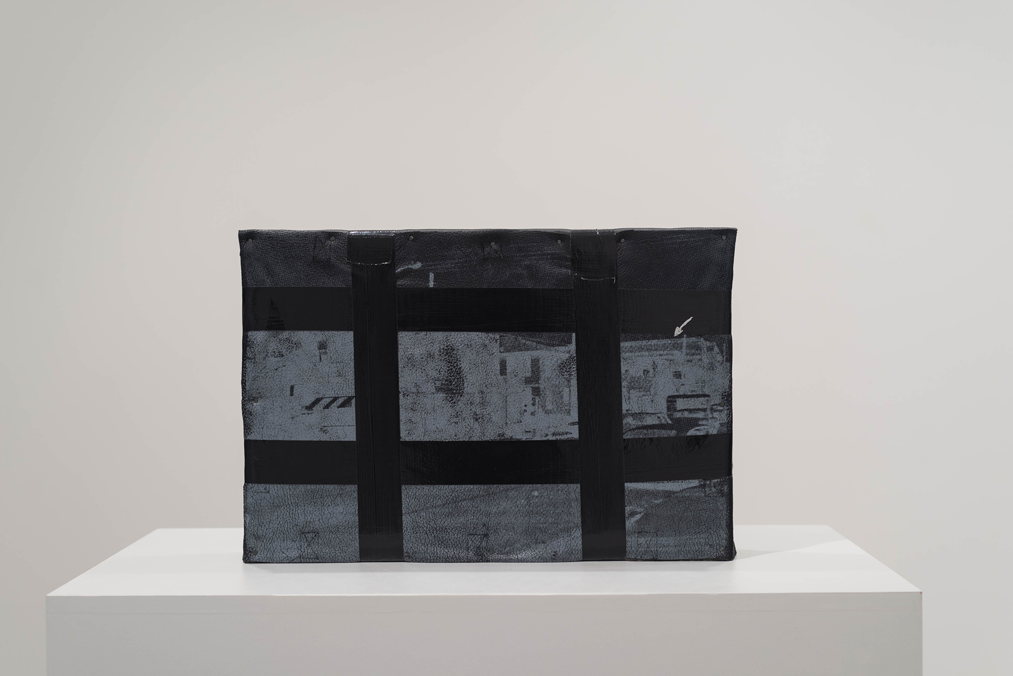 Jamal Cyrus, Phylactery to Repel Ghosts, 2014, screenprint on leather, tape, wood, tacks, 14 1/2 x 21 1/2 x 3 1/2 inches