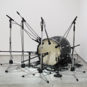 Jamal Cyrus, Untitled, 2010, drum, leather, microphones, mic stands, cables, speaker, 78 x 67 x 45 1/2 inches