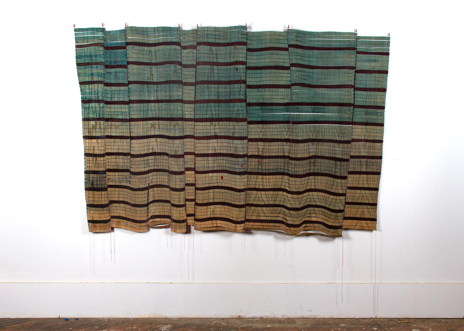 Dan Gunn, Cascade Scales, 2013, dye and polyurethane on plywood with nylon cord, 54 x 84 inches