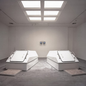 Iñigo Manglano-Ovalle, The El Niño Effect, 1997-98, installation of two sensory deprivation tanks, shower and changing room, video and sound piece, dimensions variable, installation view at Christopher Grimes Gallery, Santa Monica, CA, 1997
