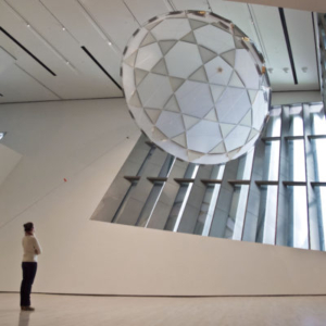 Iñigo Manglano-Ovalle, Red Factor, 2012, 20 foot diameter nylon spinnaker fabric, aluminum tubes, stainless steel cable and hardware, and taxidermy red factor canary, dimensions variable, installation view at Broad Art Museum, Michigan State University, 2012