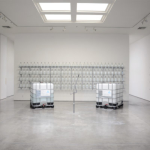 """Iñigo Manglano-Ovalle, Well 34°01'03""""N - 118°29'12""""W, 2015, 500 gallons of water from Santa Clara Pueblo, glass bottles, shelves and pump, dimensions variable"""