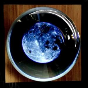 JD Beltran, Untitled (Crystal Ball), 2014, video sculpture (custom lens, video, base), 12 x 12 x 12 inches