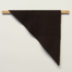 Helen Mirra, Waulked Triangle, MT01/MT02, 2013, undyed wool from two black sheep, a strand of wool dyed with Hydnellum concrescens, cord, cedar, 74.9 x 95.3 x 2.9 cm