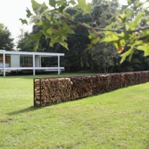 Iñigo Manglano-Ovalle, Seven Thousand Cords (After Beuys), 2014, firewood, steel frames, dimensions variable, installation view at Farnsworth House, Plano, IL, 2015