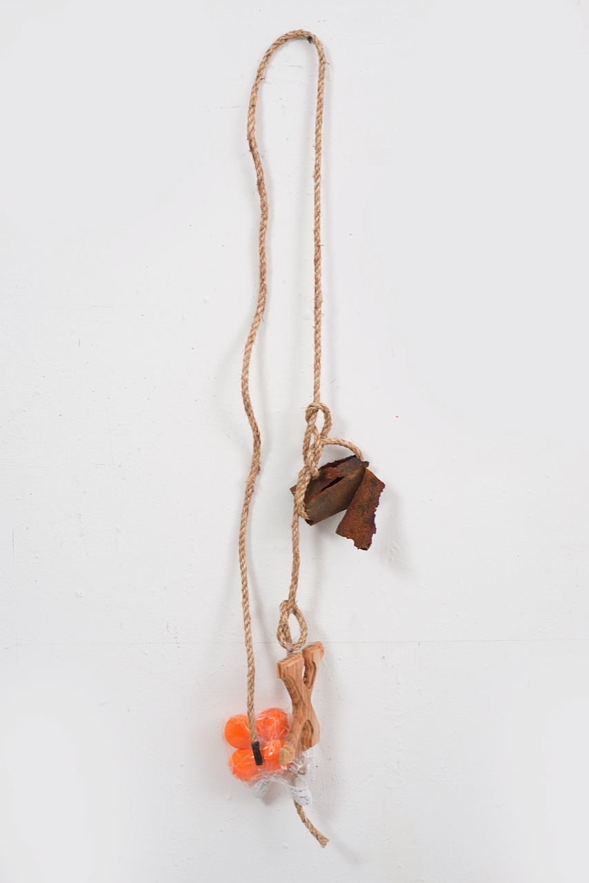 Joe Fyfe, Untitled, 2014, rope, rusted object, wood, painted Styrofoam, and plastic, 47 x 10 1/2 x 5 inches