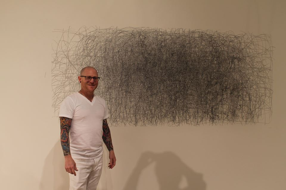 Howie Cherman, The Man Who Fell To Earth, 2014, graphite crayon on wall, 7 x 3 feet