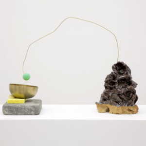 Sara Magenheimer, Choir Practice (After Adoration of the Mystic Lamb), 2015, Brass, ceramic, ping pong ball, brass singing bowl, stone, sponges, 15 x 25 inches