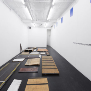 Park McArthur, Ramps, 2010-2014, 20 access ramps from various art institutions, 5 aluminum signs, vinyl wall text, dimensions variable