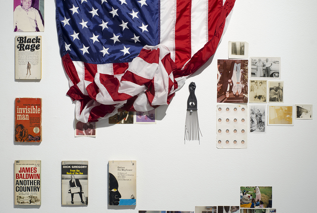 Kameelah Rasheed, No Instructions for Assembly-I (installation shot), 2013, Installation (diptychs, collages, original photographs, found photographs, human hair, American flag sewn with linen thread, Islamic prayer rugs, abaya, newspapers, books, religious tracts, mirrors, tea bags, stockings, bleaching cream, concealer, votive candle, handwritten letters, upholstered chair, album covers), variable dimensions