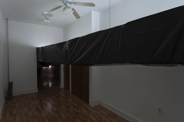 Bill Jenkins, End User Bedroom, 2014, plastic, cardboard, mylar, wood, 12 x 12 x 22 feet