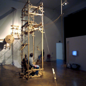 Bernie Lubell, Conservation of Intimacy, 2005, Ars Electronica, Linz, Austria, 2007, wood, latex, music wire, copper, springs, nylon line, paper, pens, black rubber rope and video surveillance, 19 (h) x 24 x 22 feet