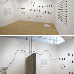 Diane Jacobs, Cross Hairs, 2005, human hair, acrylic balls, mirror, empty toilet paper rolls, letterpress text, steel, variable size