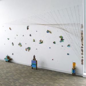 Gisela Insuaste, Mapeando (installation shot), 2015, repurposed wood, textiles, beads, vacuum cleaner belts, glass, ceramic, wool, paper, cardboard, soil, copper, mirrors, silver tape, found material, variable size