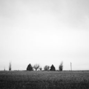 J John Priola, Imboden, 2004, gelatin-silver print, 22 1/2 x 35 3/4 inches framed, from the series Farm Sites