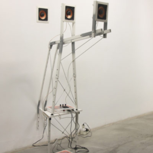 Jeff Carter, Construction E, 2012, modified IKEA products (laminated MDF, steel, plastic, hardware), speakers, amplifier, programmed Arduino microcontroller, electronics, 3-‐channel sound composition by Lou Mallozzi, 64 H x 20 W x 36 D inches
