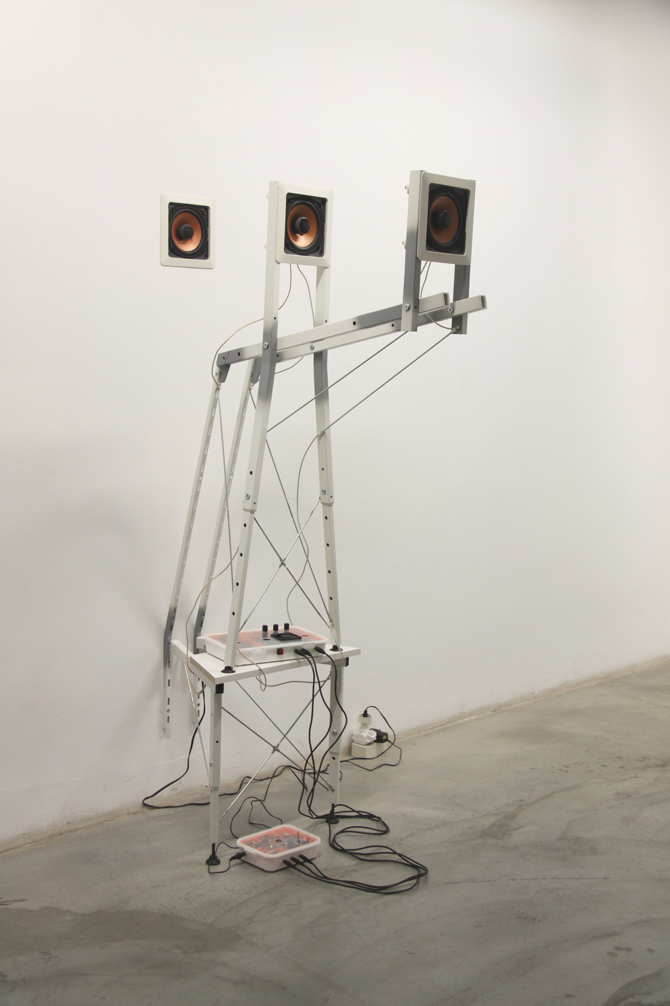 Jeff Carter, Construction E, 2012, modified IKEA products (laminated MDF, steel, plastic, hardware), speakers, amplifier, programmed Arduino microcontroller, electronics, 3-­‐channel sound composition by Lou Mallozzi, 64 H x 20 W x 36 D inches