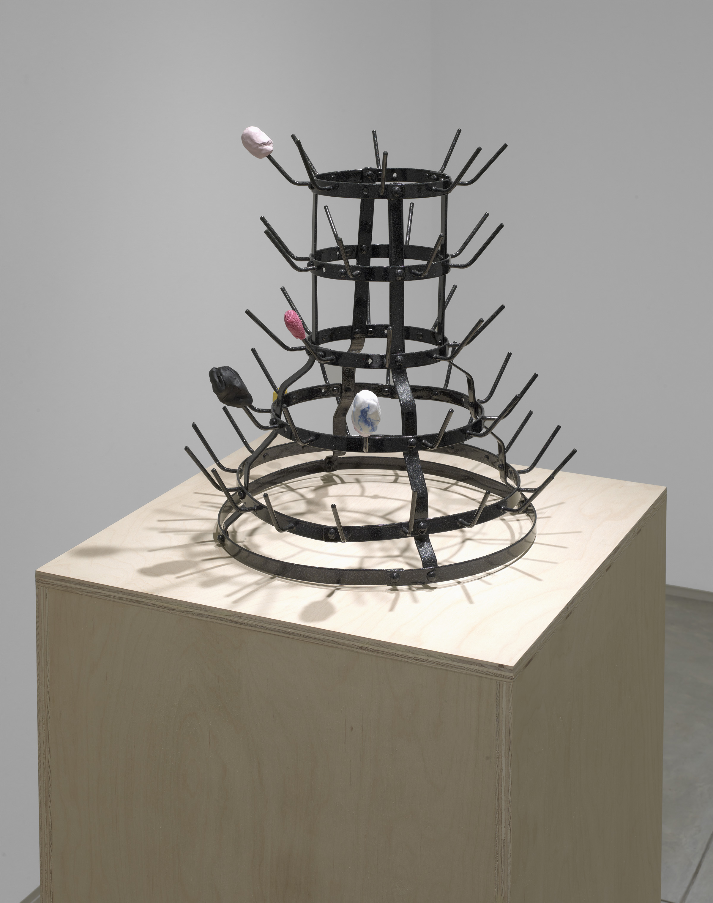 Katrina Moorhead, Trying to describe the way that space wraps itself around an object, antique bottle rack, powder coating, plasticine, bandage, 66 x 19 x 20 inches