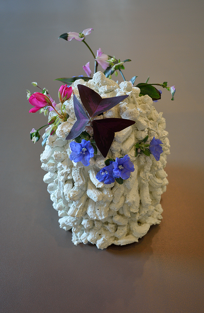Marie Krane, Regarding Perennial Time, 2015, acrylic and marble dust, with flowers, 8 x 6 x 6 inches