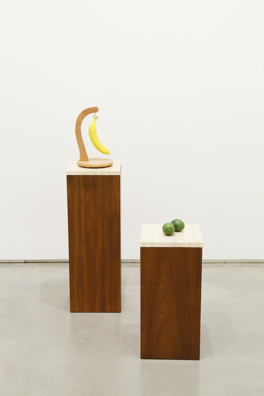 Margaret Lee, Hanging Banana and Two Limes, 2013, 2 pedestals, plaster, acrylic paint, banana holder, variable