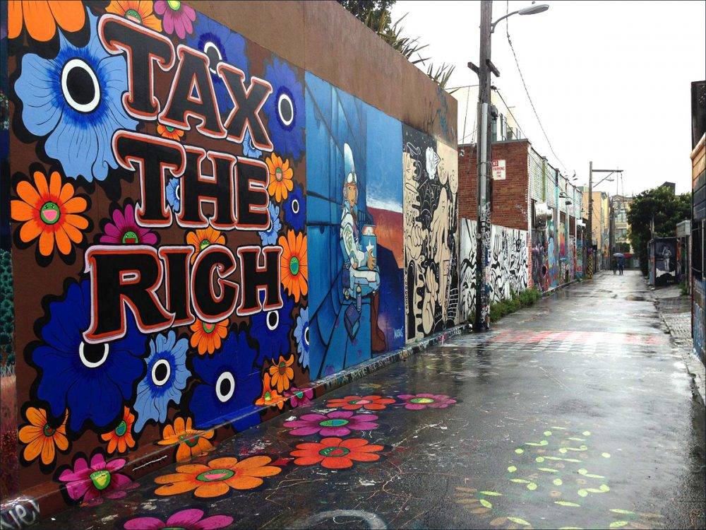 Megan Wilson, TAX THE RICH, 2013, public mural, acrylic, 13 1/2 x 13 inches