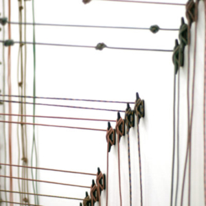 Heather Mekkelson, In Absentia Luci, 2017, elastic, aluminum, latex-toned paracord, dimensions variable