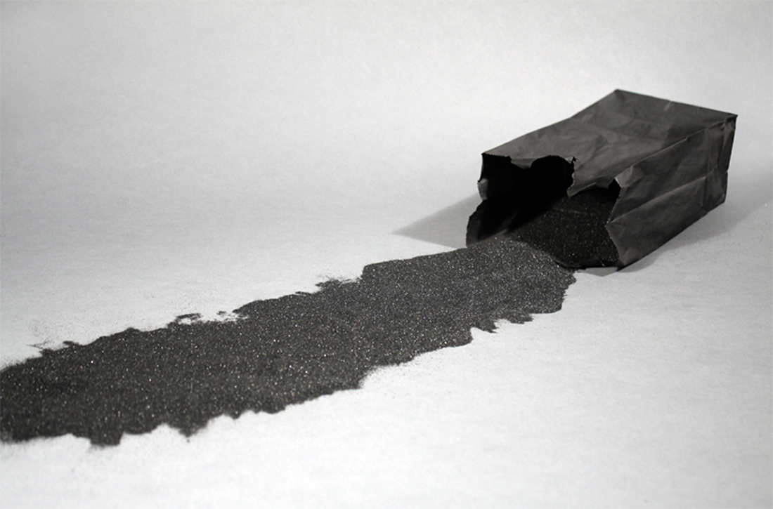 Nathaniel Donnet, Origin of the World by Funkadelic, 2014, paper bag, graphite, black sand, 10 x 5 x 3 inches
