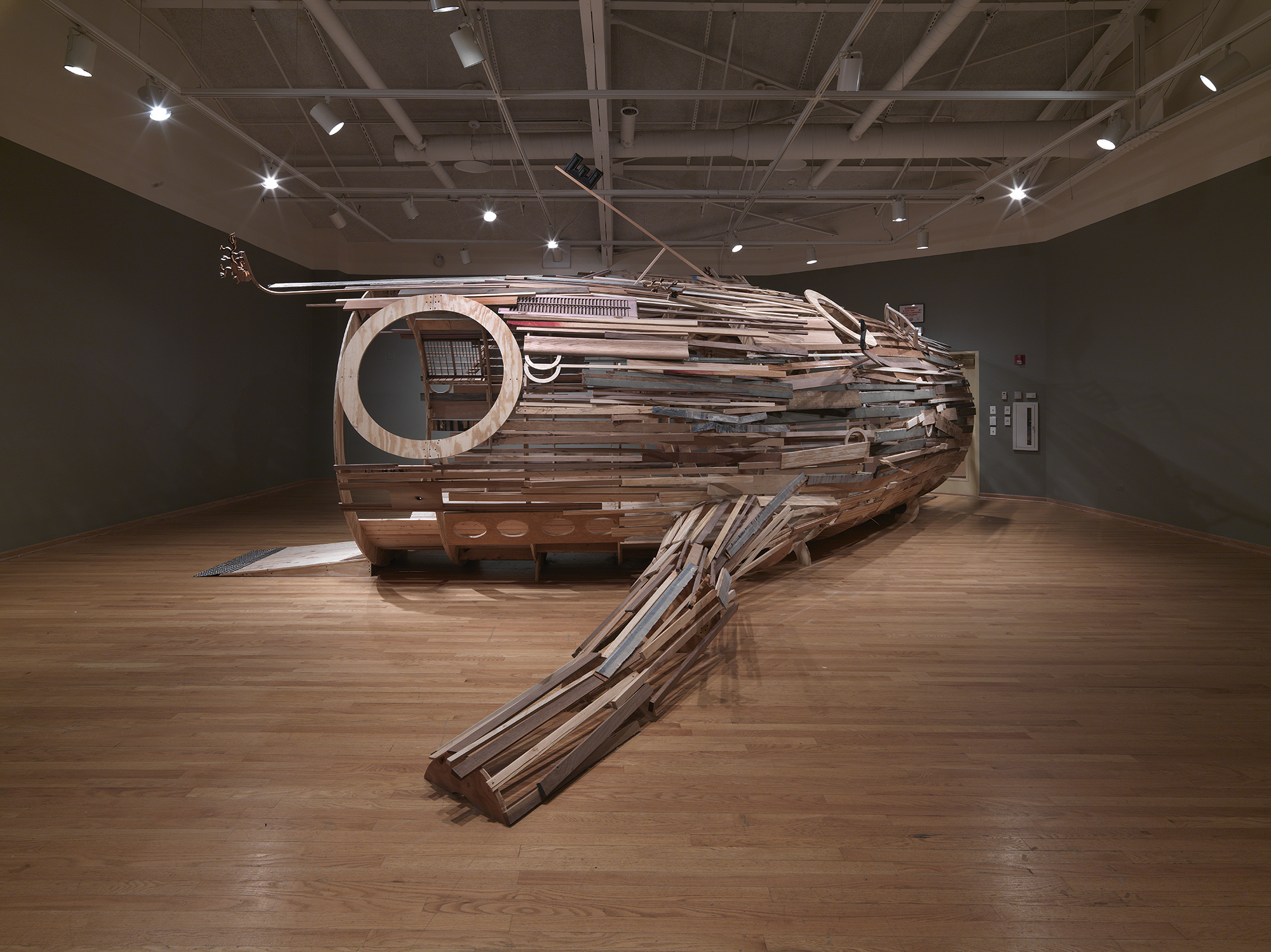 Juan Angel Chavez, Neptuno, found materials, 2011, 12 x 28 x 8 feet