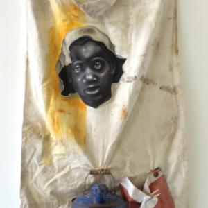 Travis Somerville, Little Boy Blue, 2014, oil and graphite on vintage cotton picking sack, metal gasoline can, US flag fragment, cotton glove, 60 x 26 x 9 inches