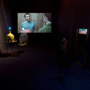 Vishal Jugdeo, Surplus Room, 2008, mixed-media installation with high-definition projection and three-channel sound, variable