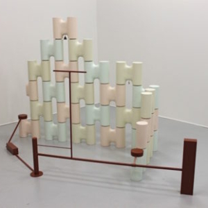 Stephen Reber, Cross Compound, 2011, plaster, wood, brass bell, charm, oil paint, 62 x 100 x 26 inches