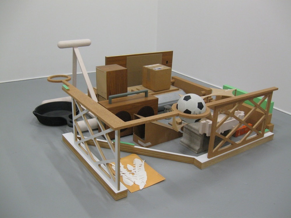 Stephen Reber, Sidelined, 2011, plywood, cork, plastic laminate, cardboard, paper, soccer ball, oil paint, 28 x 72 x 72 inches