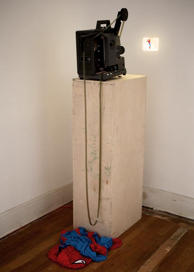 Mariah Garnett, Piderman, 2012, 10 sec 16mm film loop, projector, wood, nylon Spiderman costume