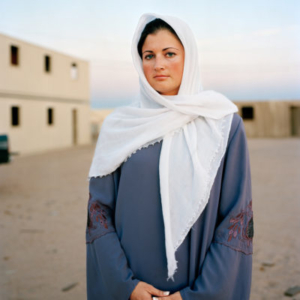 Claire Beckett, Marine Lance Corporal Nicole Camala Veen playing the role of an Iraqi nurse in the town of Wadi Al-Sahara, Marine Corps Air Ground Combat Center, CA, 2008, 2008, archival inkjet photograph, 30 x 40 inches