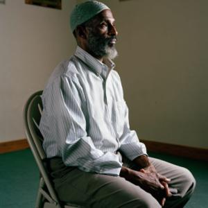 Claire Beckett, Imam Taalib Mahdee, 2013, archival inkjet photograph, 30 x 40 inche