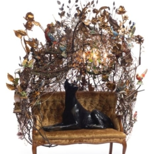Nick Cave, Sculpture, 2013, mixed media including ceramic Doberman, birds, metal flowers, vintage settee, strung beads, and light fixture, 88 x 72 x 44 inches. Photo by James Prinz Photography. Courtesy of the artist and Jack Shainman Gallery, New York