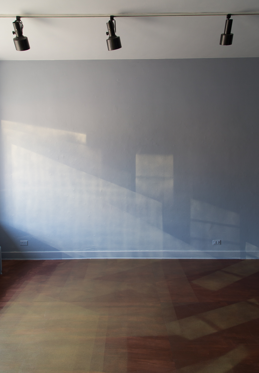 Paola Cabal, Crescent, 2015, interior latex and spray paint on walls, ceiling, and stained birch plywood floor panels overlaid on existing floor, wall height 10 feet 11 inches