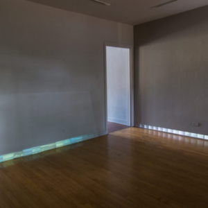 Paola Cabal, To and From, 2015, two channel video installation projected onto gallery baseboards