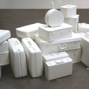 Amy Wilson Faville, Departure, 2012, suitcases, recycled paint, dimensions variable