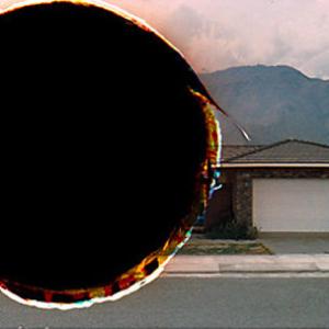 Amie Siegel, Black Moon / Hole Punches, 2010, C-print 13 1/2 x 24 inches. Image courtesy of www.amiesiegel.net