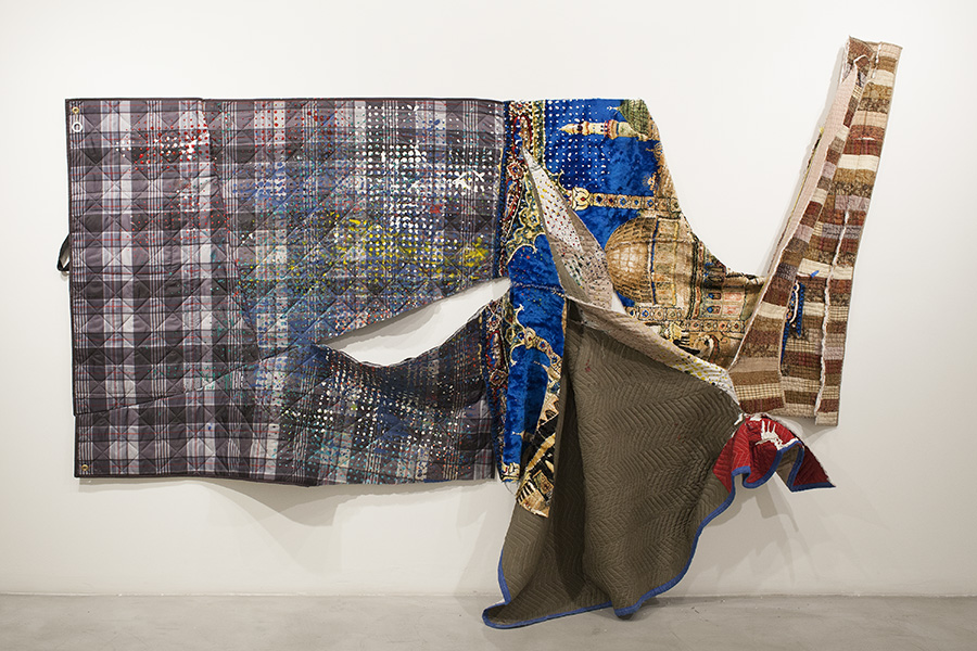Eric Mack, Rare Essence, 2015, acrylic on picnic blanket, islamic rug, moving blanket, quilt reminisce with thread, glue and grommets, 127 x 85 x 12 inches