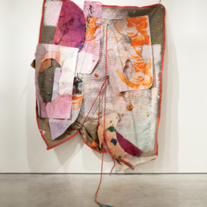 Eric Mack, Pain After Heat, 2014, rope, paper, acrylic paint, dye, ink, dried orange peel, wood, plastic, magazine images and grommets on a quilted moving blanket, 77 x 90 x 49 inches
