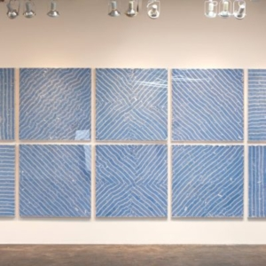 Joseph Havel, HOPE and desire, 2012, shirt labels, plexiglas and wood (10 pieces), 87 x 220 1/2 x 2 inches installed