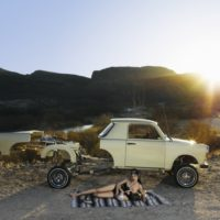 Liz Cohen, Lowrider Builder and Child, 2012, C-print, 50 × 63 inches. Image courtesy of www.salon94.com