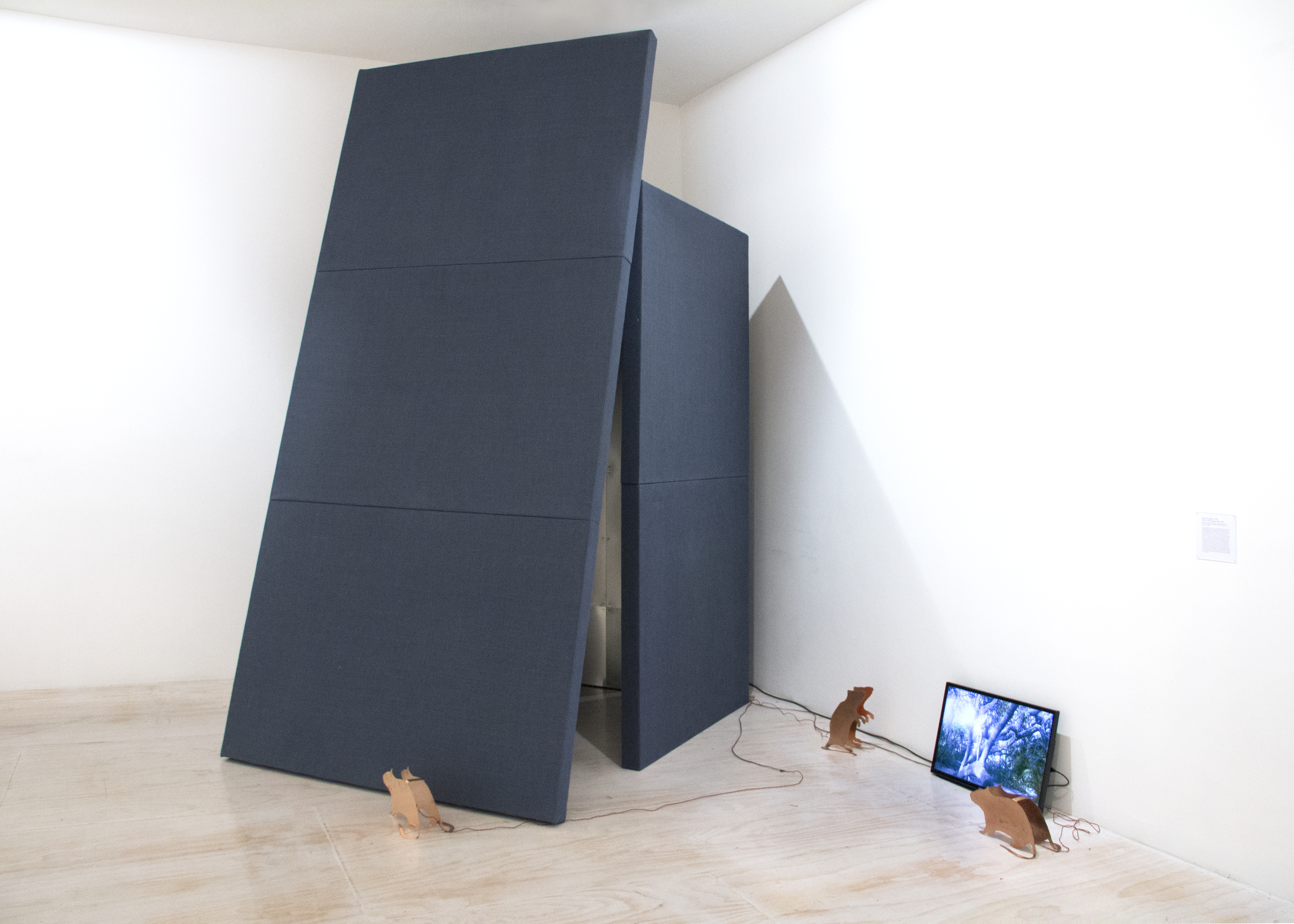 Sergei Tcherepnin, Piper's Cave, 2013, burlap, aluminium, zinc, black zinc, c-prints, wood, sound insulation, transducers, 4 amplifiers, Blu-Ray disc with 8 channels of sound, total running time: 21 minutes, 56 seconds, 132 x 108 x 72 inches