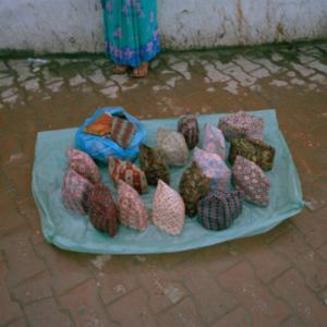 Surendra Lawoti, Hat vendor, near Ratna Park, 2012. Image courtesy of www.surendralawoti.com