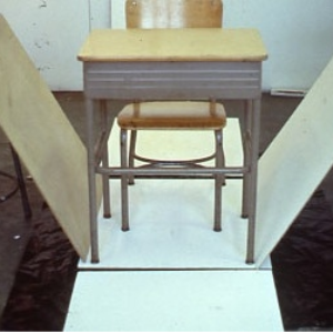 Martha Schlitt, Block - early state, 1994, school desk, chair, luan panels, 29 x 24 x 31 inches. Image courtesy of www.marthschlitt.com
